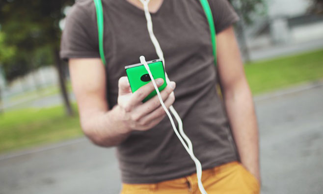 Man listening to music while walking